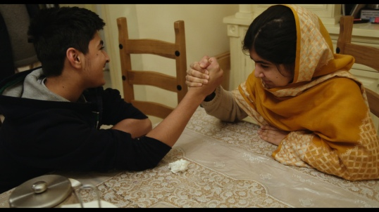 HE NAMED ME MALALA: Khushal Yousafzai and Malala Yousafzai in Birmingham, England. Dec 16, 2013. Photo courtesy of Fox Searchlight Pictures. © 2015 Twentieth Century Fox Film Corporation All Rights Reserved